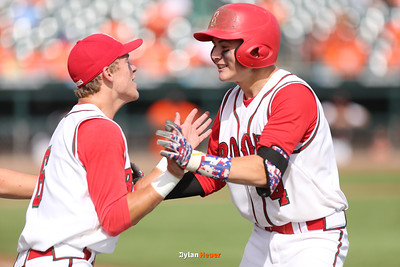 Boone's Nolan Newcomb celebrates his three-run error with Danny Anderson during the sixth inning in a Class 3A Quarterfinals game at Principal Park in Des Moines, Iowa on Wednesday, July 29, 2015. (Photo by Dylan Heuer/Iowa Cubs)