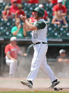 Bella's Marcus Wittmer celebrates after scoring during the third inning in a Class 3A Semifinals game at Principal Park in Des Moines, Iowa on Friday, July 31, 2015. (Photo by Dylan Heuer/Iowa Cubs)