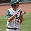 Pella's Grant Judkins celebrates after scoring a run during the fifth inning in a Class 3A Semifinals game at Principal Park in Des Moines, Iowa on Friday, July 31, 2015. (Photo by Dylan Heuer/Iowa Cubs)