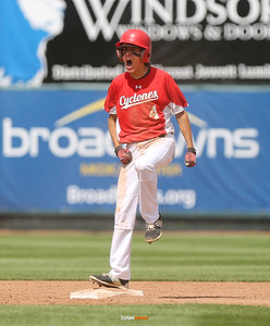 Harlan's Brett Sears, an eight-grader, celebrates his game-winning, two-run double during the seventh inning in a Class 3A Semifinals game at Principal Park in Des Moines, Iowa on Friday, July 31, 2015. (Photo by Dylan Heuer/Iowa Cubs)
