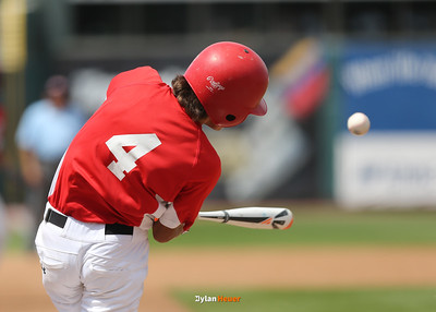 Harlan's Brett Sears, an eight-grader, hits a game-winning, two-run double during the seventh inning in a Class 3A Semifinals game at Principal Park in Des Moines, Iowa on Friday, July 31, 2015. (Photo by Dylan Heuer/Iowa Cubs)