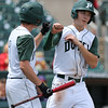 Bella's Tyler Hillman celebrates after scoring a run with Jordan Meyer during the third inning in a Class 3A Semifinals game at Principal Park in Des Moines, Iowa on Friday, July 31, 2015. (Photo by Dylan Heuer/Iowa Cubs)