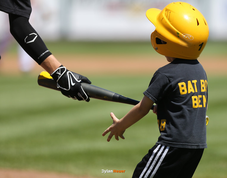 WSR bat boy Ben retrieves a bat from a player during the fourth inning in a Class 3A Semifinals game at Principal Park in Des Moines, Iowa on Friday, July 31, 2015. (Photo by Dylan Heuer/Iowa Cubs)