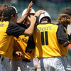 Teammates mob Dalton Steere (#11) after he hit a two-run, walk-off single that lifted WSR to a 12-2 victory over Boone after a Class 3A Semifinals game at Principal Park in Des Moines, Iowa on Friday, July 31, 2015. (Photo by Dylan Heuer/Iowa Cubs)