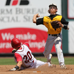 WSR shortstop Dalton Graven attempts to complete a double play over Boone's Colby DIsbrowe during the fifth inning in a Class 3A Semifinals game at Principal Park in Des Moines, Iowa on Friday, July 31, 2015. (Photo by Dylan Heuer/Iowa Cubs)
