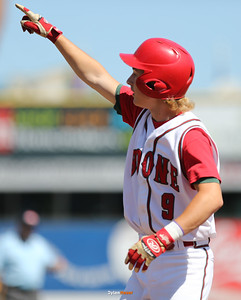 Boone's Jackson Hull celebrates after hitting an RBI single during the second inning in a Class 3A Semifinals game at Principal Park in Des Moines, Iowa on Friday, July 31, 2015. (Photo by Dylan Heuer/Iowa Cubs)