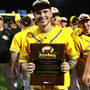 SE Polk's Sam Henry holds up his Player of the Game award after the Class 4A State Championship at Principal Park in Des Moines, Iowa on Saturday, August 1, 2015. (Photo by Dylan Heuer/Iowa Cubs)