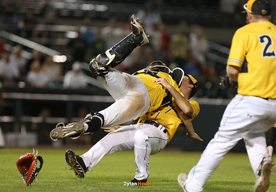 Catcher Austin Martin jumps on starter Thomas McLaughlin as they celebrate SE Polk's 6-2 victory over IC West after the Class 4A State Championship at Principal Park in Des Moines, Iowa on Saturday, August 1, 2015. (Photo by Dylan Heuer/Iowa Cubs)