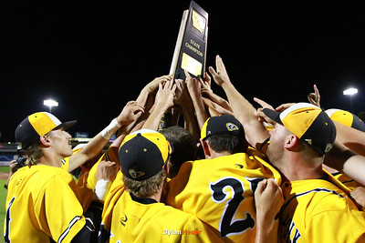 SE Polk hoist up their trophy after the Class 4A State Championship at Principal Park in Des Moines, Iowa on Saturday, August 1, 2015. (Photo by Dylan Heuer/Iowa Cubs)