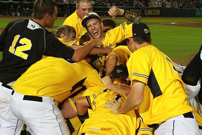 SE Polk celebrates their 6-2 victory over IC West after the Class 4A State Championship at Principal Park in Des Moines, Iowa on Saturday, August 1, 2015. (Photo by Dylan Heuer/Iowa Cubs)