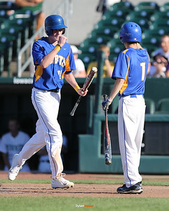 North's Collin Guinn celebrates after scoring a run with Nicl Wailand during the fourth inning in a Class 4A Quarterfinals game at Principal Park in Des Moines, Iowa on Wednesday, July 29, 2015. (Photo by Dylan Heuer/Iowa Cubs)
