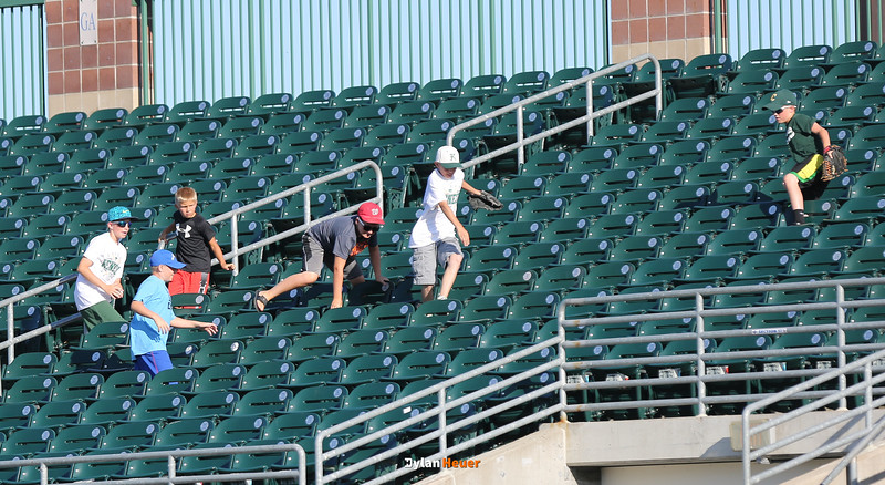 Young fans chase after a foul ball in a Class 4A Quarterfinals game at Principal Park in Des Moines, Iowa on Wednesday, July 29, 2015. (Photo by Dylan Heuer/Iowa Cubs)