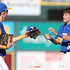 North's Collin Guinn gives Ben Beutel his glove and cap during the fifth inning in a Class 4A Quarterfinals game at Principal Park in Des Moines, Iowa on Wednesday, July 29, 2015. (Photo by Dylan Heuer/Iowa Cubs)