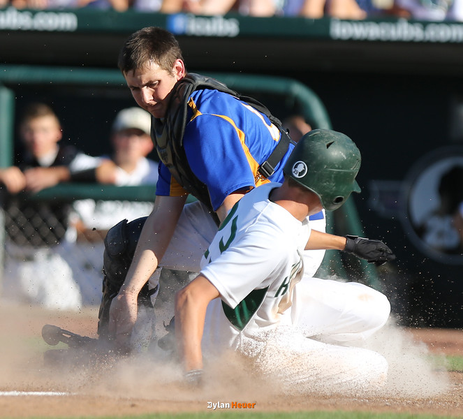 Kennedy's Mitchell Gaffey scores past North catcher Henry Runge during the fifth inning in a Class 4A Quarterfinals game at Principal Park in Des Moines, Iowa on Wednesday, July 29, 2015. (Photo by Dylan Heuer/Iowa Cubs)