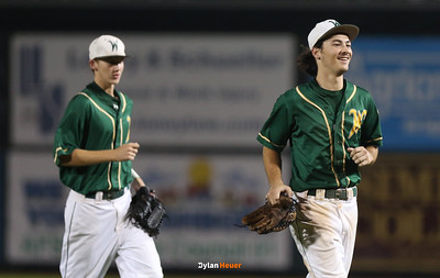 Kevin Delaney and Nate Disterhoft celebrate IC West's 11-3 victory over DM East after a Class 4A Quarterfinals game at Principal Park in Des Moines, Iowa on Wednesday, July 29, 2015. (Photo by Dylan Heuer/Iowa Cubs)