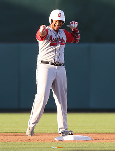 DM East's Chino Alcala celebrates his two-run double during the first inning in a Class 4A Quarterfinals game at Principal Park in Des Moines, Iowa on Wednesday, July 29, 2015. (Photo by Dylan Heuer/Iowa Cubs)