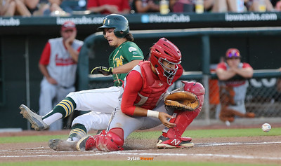 IC West's Kevin Delaney scores past DM East catcher Jaylin James during the fourth inning in a Class 4A Quarterfinals game at Principal Park in Des Moines, Iowa on Wednesday, July 29, 2015. (Photo by Dylan Heuer/Iowa Cubs)