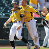 SE Polk's Tim Neff and Sam Henry celebrate after they scored a pair of runs during the third inning in a Class 4A Quarterfinals game at Principal Park in Des Moines, Iowa on Wednesday, July 29, 2015. (Photo by Dylan Heuer/Iowa Cubs)