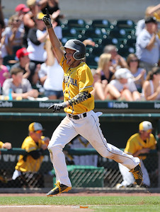 SE Polk's Tim Neff celebrates as he scores a run during the third inning in a Class 4A Quarterfinals game at Principal Park in Des Moines, Iowa on Wednesday, July 29, 2015. (Photo by Dylan Heuer/Iowa Cubs)