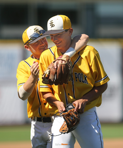 Cam Shannon and Alex Pierce celebrate SE Polk's 12-0 victory over SC East after a Class 4A Quarterfinals game at Principal Park in Des Moines, Iowa on Wednesday, July 29, 2015. (Photo by Dylan Heuer/Iowa Cubs)
