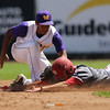 Waukee shortstop Isaiah Thomas tags out North Scott's Matt Sacia during the fourth inning in a Class 4A Quarterfinals game at Principal Park in Des Moines, Iowa on Wednesday, July 29, 2015. (Photo by Dylan Heuer/Iowa Cubs)