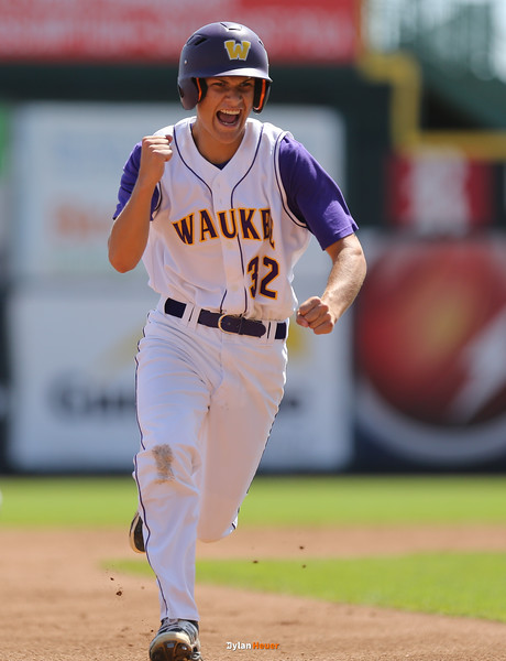 Waukee's Walker McDonald celebrates as he rounds third base to score during the first inning in a Class 4A Quarterfinals game at Principal Park in Des Moines, Iowa on Wednesday, July 29, 2015. (Photo by Dylan Heuer/Iowa Cubs)