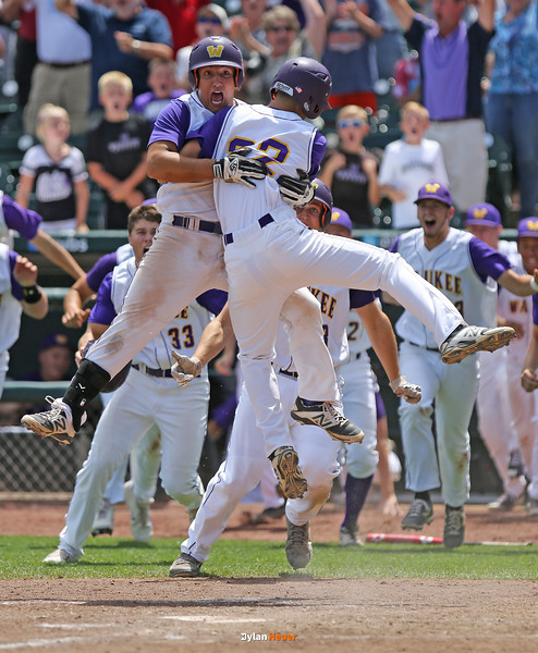Bryce Hingst and Walker McDonald celebrate Waukee's 6-5 walk-off victory over North Scott in a Class 4A Quarterfinals game at Principal Park in Des Moines, Iowa on Wednesday, July 29, 2015. (Photo by Dylan Heuer/Iowa Cubs)