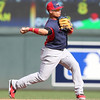 Javier Baez of the World Team (Cubs) throws the ball to first base for an out at Target Field in Minneapolis, Minnesota on Sunday, July 13th, 2014.