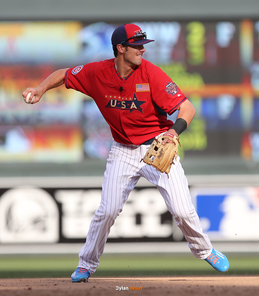 Kris Bryant of the United States (Cubs) fields a ground ball and throws the ball to first base at Target Field in Minneapolis, Minnesota on Sunday, July 13th, 2014.