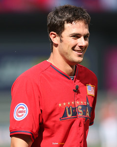 Kris Bryant of the United States (Cubs) smiles as he awaits his cap and glove from a teammate at Target Field in Minneapolis, Minnesota on Sunday, July 13th, 2014.