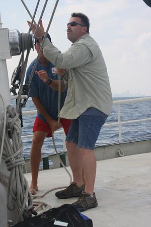 Darin hoisting the sails
