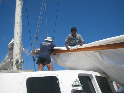 Captain John and Rudy packin' up the sails