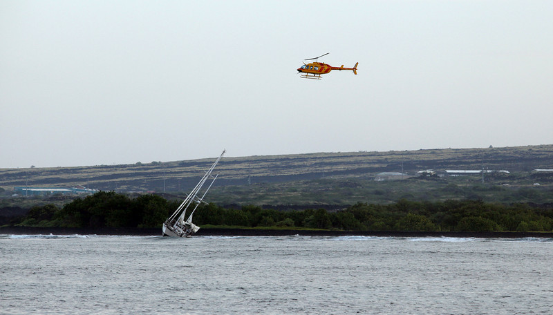 The Coast Guard arriving at a beached yacht stolen the previous evening by a non-sailor drifter