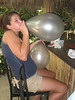 Bar patron blowing up balloons for the evening's wedding ceremonies.