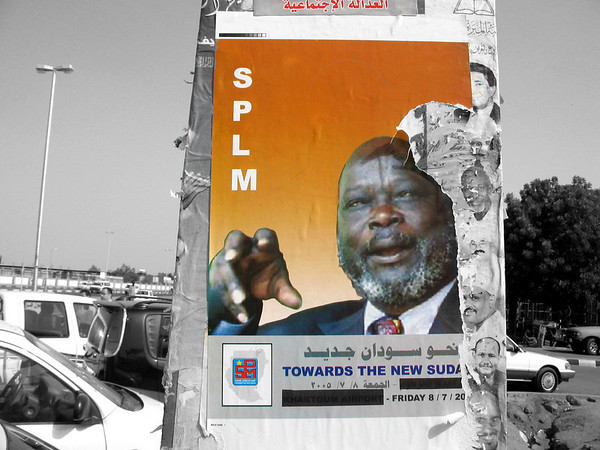 July the 9th 2005. Posters of Dr. John Garang de Mabior were hanging everywhere in Khartoum (Sudan). Dr. Garang is the leader of the Sudan's People Liberation Movement since 1983. Earlier in January 2005 he signed a peace agreement with the Sudanese governement and today he is returning to Khartoum for the first time since 1983. Millions of sudanese people celebrated his return and gave him a heroic welcome. <br /> Two weeks later he died in a plane accident !!!!????