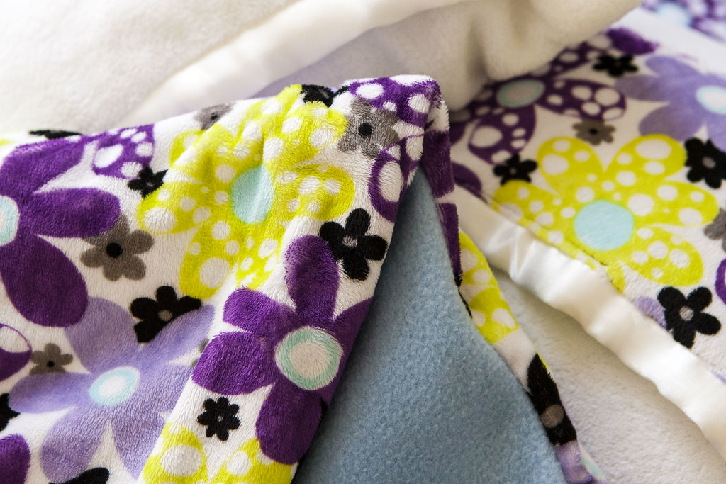 Detail of coordinating duvet cover for sleeping bag and Pillowcases made from baby blankets for bolsters and camp pillows