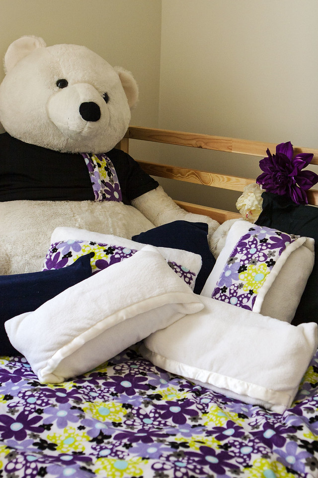 Burr the polar bear with pillowcases made from baby blankets for bolsters and camp pillows with coordinating duvet