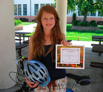 Alissa showing her Skills & Safety certificate (Bike Adventure)