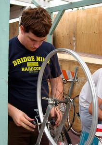 Josh truing a wheel
