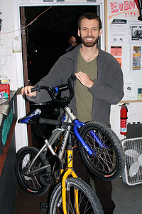 Cameron riding in with a donated bike.