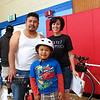 Carmen & a happy family who won a bike