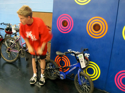 Dylan (a Bike monkey @SBMS) inflating a tire