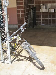 Bike attached at a gate