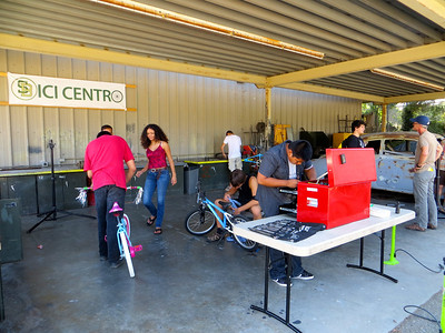 Fixing young kids bikes for the Family Day & Health Fair at SBJH