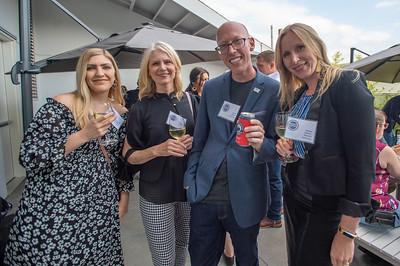 DLR Group staff enjoy a laugh at the Reader Ranking event Wednesday at the Jupiter Next hotel. (Josh Kulla/DJC)