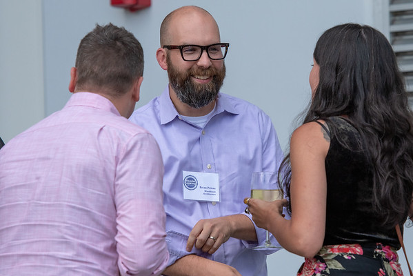 Brian Peters of Woodblock Architecture enjoys a laugh with colleagues Wednesday at the DJC's Reader Rankings event. (Josh Kulla/DJC)