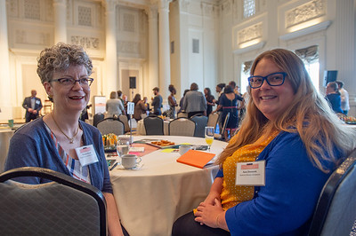 Valerie Evans, left, of David Evans and Associates, chats with Ankrom Moisan Architects marketing manager Sara Drenzek. (Josh Kulla/DJC)