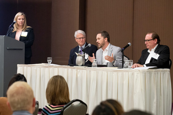 Dan Dias, third from left, economic and community development director with the city of Hillsboro, speaks about Reed's Crossing Thursday. Also pictured, from left, are Stephanie Holmberg, David Brentlinger and Frank Angelo. (Sam Tenney/DJC)