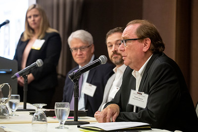 Frank Angelo, right, principal with land use and transportation planning firm Angelo Planning Group, speaks during the DJC's Builder Breakfast Thursday in downtown Portland. (Sam Tenney/DJC)