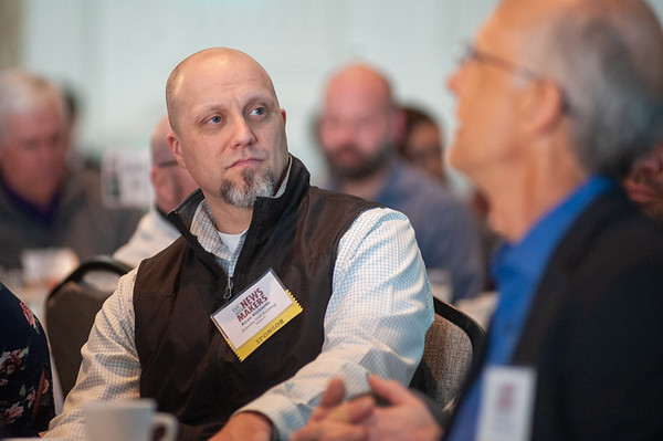 Skanska USA Building Senior Project Manager Ryan Richards watches the awards ceremony. (Josh Kulla/DJC)